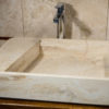 "Lavabo di design in travertino ""Loaded"""