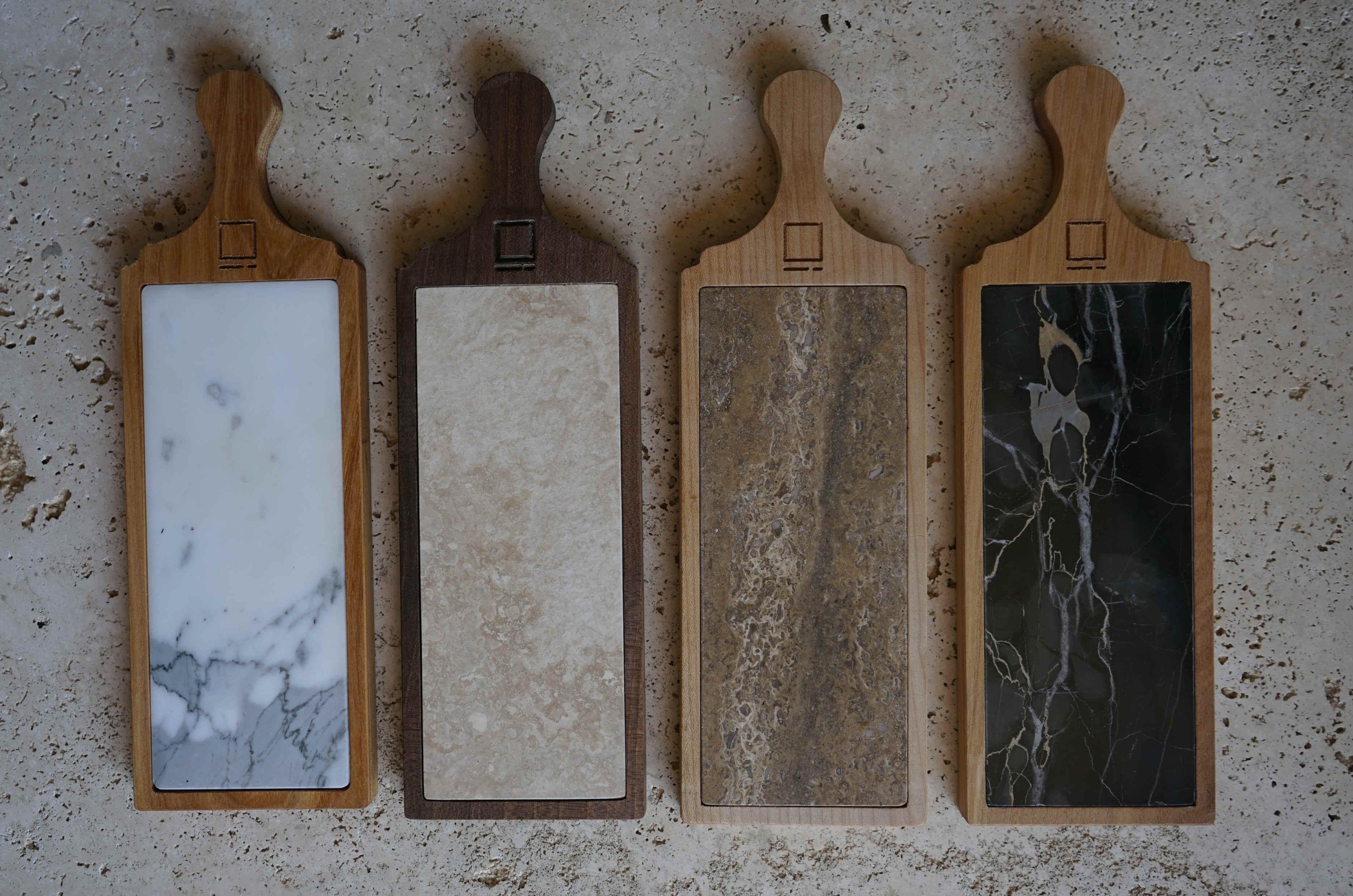 Taglieri artigianali in travertino e marmo