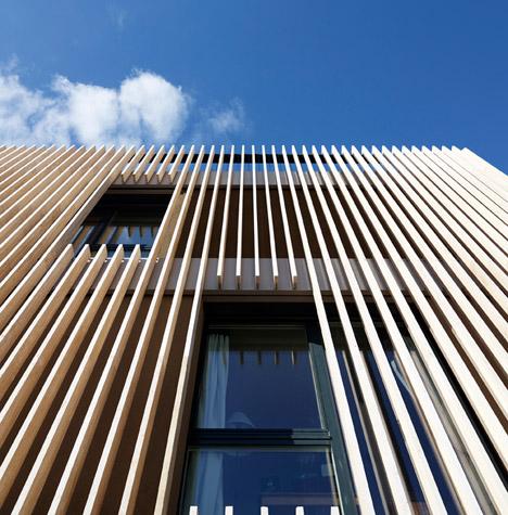 Group asia architettura rivestimento travertino striped living travertine facade